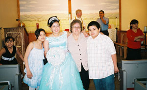 Kimberly Sanchez, holding a bouquet, with her immediate family