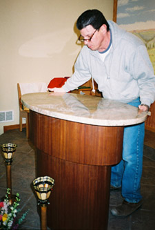 Mike Cassilla here installs a new top for the altar.