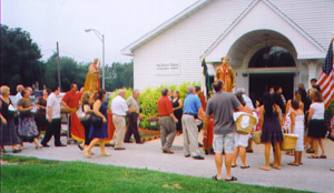 At the entrance of the church, the procession pauses.