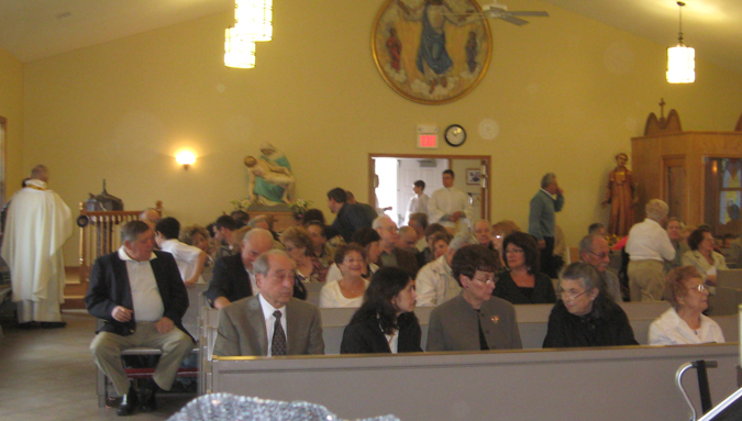 Before Easter Sunday Mass, 2011, every available place is occupied. Full House.