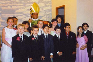 Bishop Perry and those confirmed & given First Holy Communion