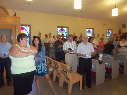 During the baptism, the entire congregation joins in the singing.