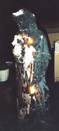 Statue of St Rocco, burnt to a crisp. Note the holes in the statue.