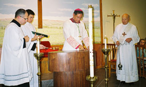 Bishop Perry anoints the altar with blest oil