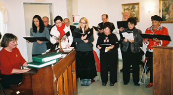 Christmas Mass: Marty Kabbes Hesse, pianist, and St. Rocco Choir
