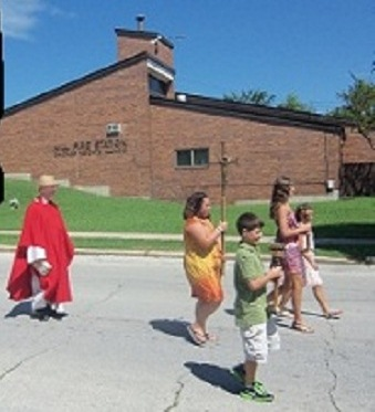 On the left is Father Gilligan, in red, commemorating the martyr St. Lawrence.