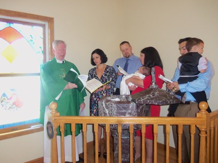 August 28, 2011: For the baptism of Nadia Martinez, the parents and godparents gather at the font.