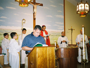 Mike Pena reads the second blessing before the Shema, the