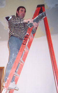 Worker finishing the ceiling