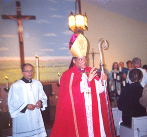 Bishop Perry, as he leaves the sanctuary at St. Rocco
