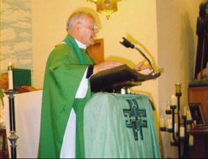 Father Petrongelli preaching at Sunday Mass