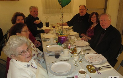 From the left are Josephine Granno, Jo Maria, two others, Tom & Celeste Jones, and Father Gilligan