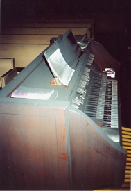 Note that the organ and music are covered in soot.