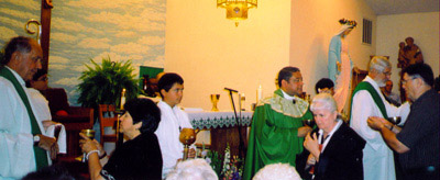 Communion at Centennial Mass