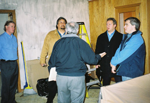 Paul Grossi (center, with his back to us) goes over damage to the church