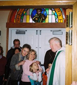 Catechumen is met at the door of the Church