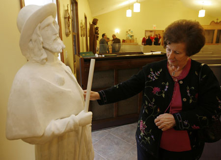 Maria Panici, checking out the restored statue of St. Rocco