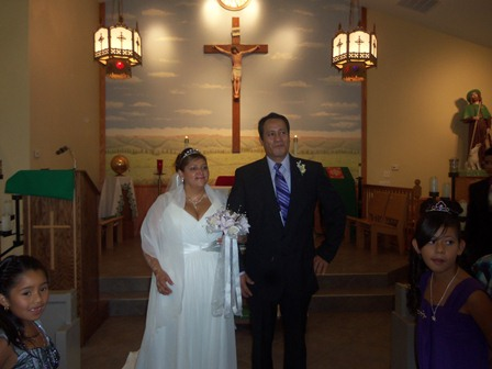 Here, after Mass, the couple process out of the church building.
