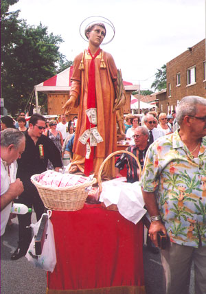 St. Lawrence himself, being carried in the procession