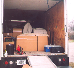 Crucifix, statues, stations, etc. are packed away in the truck, to be cleaned and restored offsite.