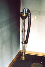 Wilted paschal candle in baptistry