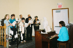 The choir sings the Shema, with the people.