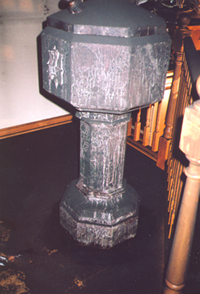baptismal font, from the old Church of St. Rocco