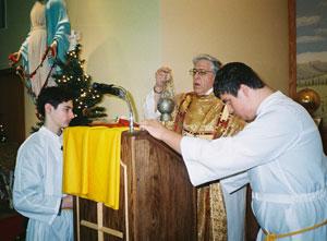The deacon incenses the Gospel Book.