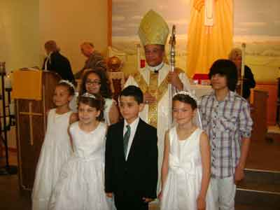 Bishop Joseph Perry with those receiving confirmation and First Communion, May 18, 20l4