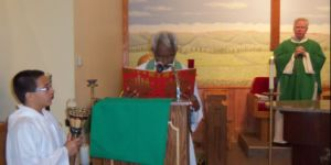 After singing the Gospel, Father Jacob venerates the Gospel Book