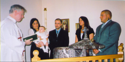 April 15, 2007: Baptism of Rocco, son of Christy Brown and Jason DeBergh, on the right.