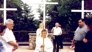 Sarah Cameli is on the left, in the Corpus Christi procession outside