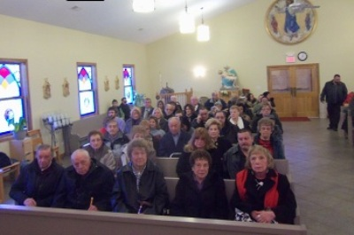 Assembly for the Jim Petrongelli Memorial Mass: east side of church. More people came in, after this photo was taken.
