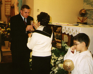 Jon Niemi receiving Communion
