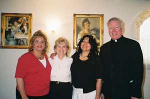 Three catechists, Mary, Lucy, and Yvette, with Father Gilligan