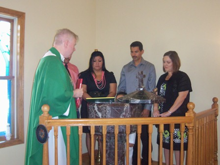 Here, before the baptism, the parents and godparents profess their faith.