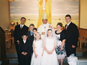 Bishop Perry with the 8 children confirmed