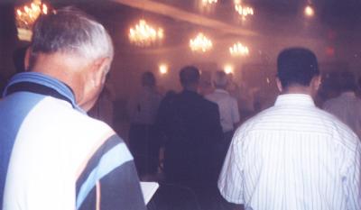 Charles Nardoni following the Coptic liturgy in English