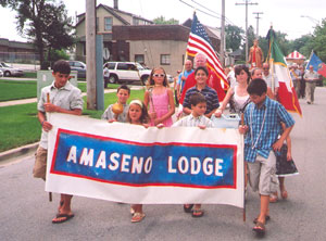 Kids lead the procession, carrying the banner