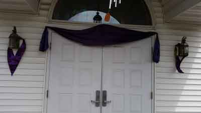 Mourning bunting atop the front doors of San Rocco church